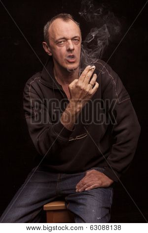 middle age man smoking cigarette