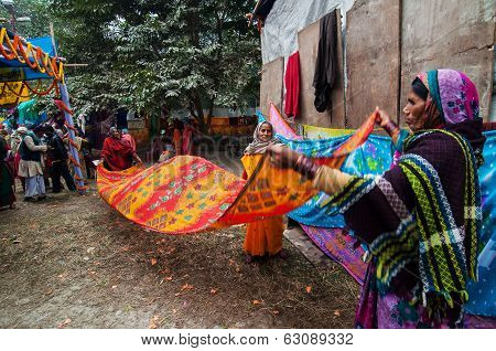 Rural Indian Women Drying Sari