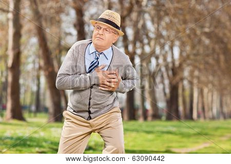 Senior having a cardiac arrest outdoors, in the park