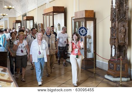 Tourists On Guided Tour In Hermitage