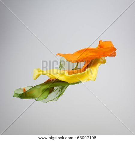 abstract pieces of fabric flying, high-speed studio shot