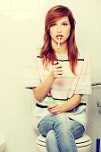 stock photo of teen smoking  - Teen girl caught on smoking in bathroom - JPG