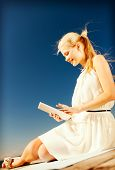 internet and lifestyle - young woman working with tablet pc outdoors