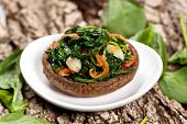 pic of portobello mushroom  - Stuffed mushroom with spinach and bacon. Selective focus. Macro with shallow dof.