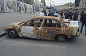 KIEV, UKRAINE - APR 7, 2014: Downtown of Kiev.Situation in the city.Burned car.Riot in Kiev and West