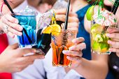 stock photo of fancy-dress  - Friends drinking with barkeeper cocktails in fancy night club - JPG