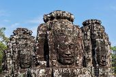 ANGKOR THOM, CAMBODIA - DECEMBER 20, 2013: Ancient stone faces of Bayon temple, Angkor, Cambodia