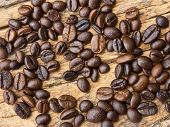 Coffee Beans  On Wood Background .
