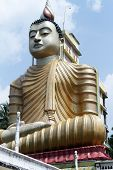 stock photo of vihara  - Big statue of Buddha in Wewurukannala Vihara near Dikwella Sri Lanka - JPG