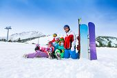 stock photo of snowboarding  - Group of five happy smiling snowboarders with snowboards and skis in the mountains - JPG