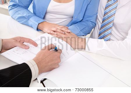 Financial Advisor is explaining a contract - young couple