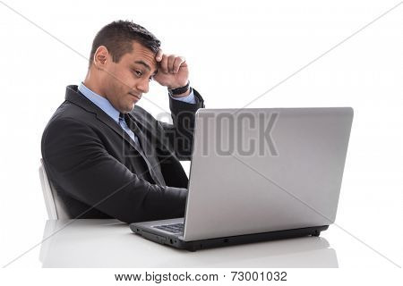 Overworked and stressed businessman isolated on white with laptop.