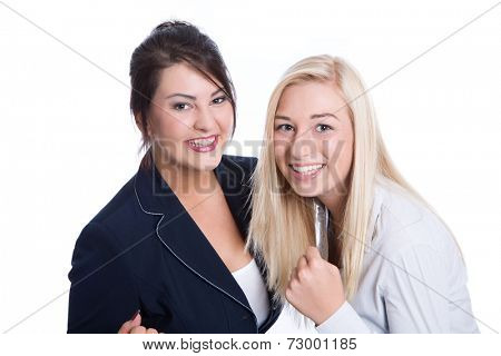 Success: two satisfied business women smiling in business outfits on white background