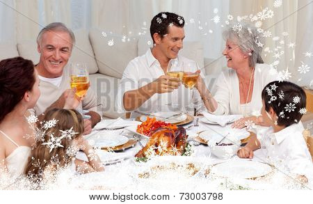 Composite image of a Parents and grandparents tusting with wine in a dinner against snow