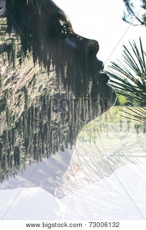 Double exposure portrait of attractive lady combined with mountainous landscape