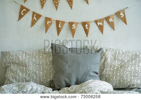 Bedroom with Christmas decorations on the wall