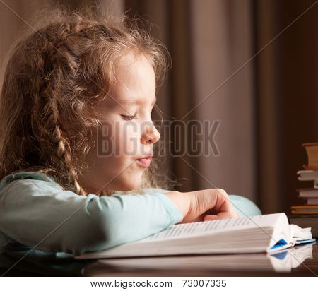 Girl reading book. Child education