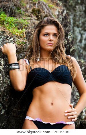 Attractive Young Woman Wearing A Black Bikini