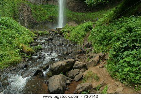 rocky stream below waterfall