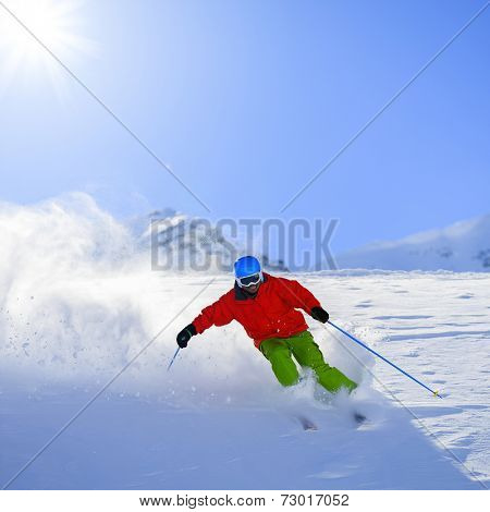 Skiing, Skier, Freeride in fresh powder snow - man skiing downhill