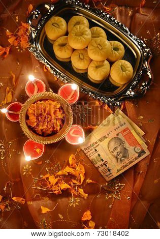 worshiping Indian currency notes as a god of wealth during Diwali Festival
