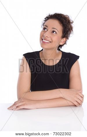 Pretty isolated young businesswoman looking sideways up to text.