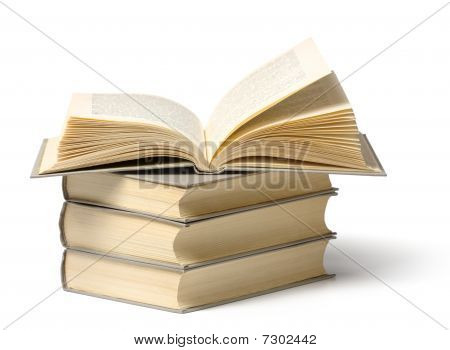 A Pile Of Books, Top One Is Open