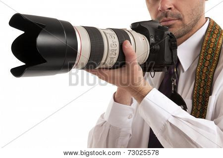 Close-up of a man holding slr camera over white background