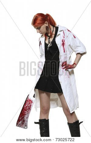 Portrait of female doctor with blooded cleaver on white background