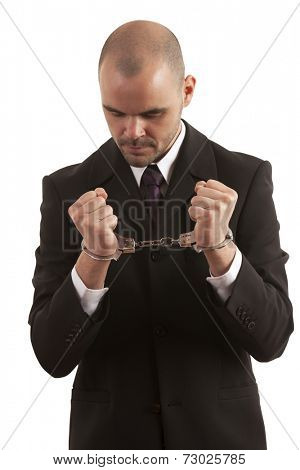Handcuffed Businessman standing over white background
