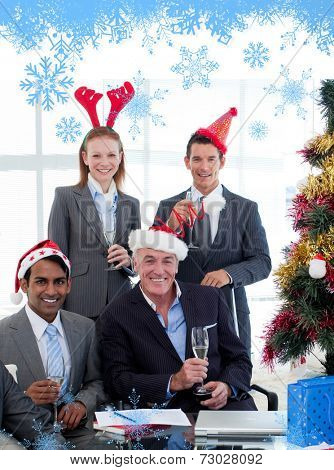 Smiling business people wearing novelty Christmas hat against snow flake frame in blue