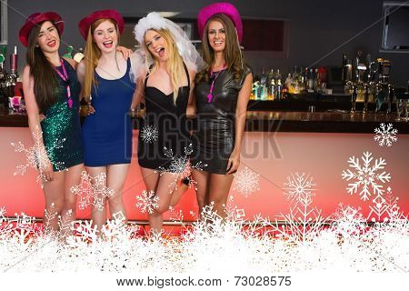 Portait of laughing friends having a hen party against snowflakes