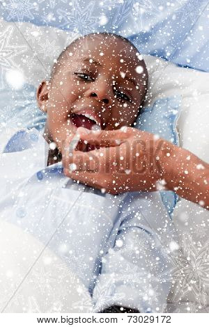 Small Boy sick in bed against snow falling