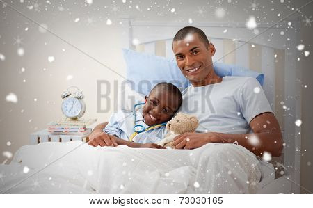 Composite image of father with his sick child against snow falling