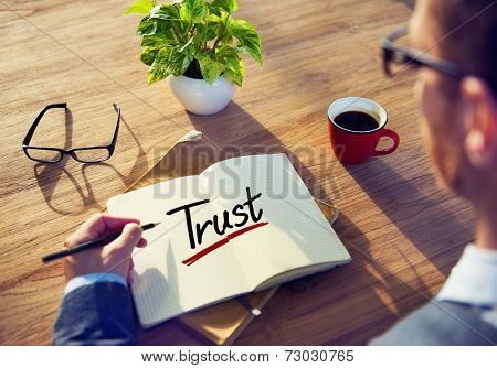 Man with a Note and a Single Word Trust