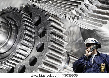 mechanical engineer, worker with giant cogwheels and gears machinery