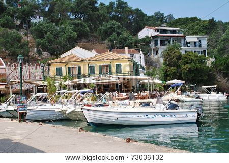 PAXOS, GREECE - JUNE 16, 2014: Boats moored in the harbour at Lakka on the Greek island of Paxos. Lakka is the Northern port of the 13km long Ionian island.
