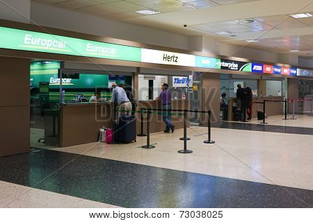 VALENCIA, SPAIN - SEPTEMBER 25, 2014:  Rental car counter at the Valencia Airport. Approximately 4.98 million passengers passed through the Valencia airport in 2013.