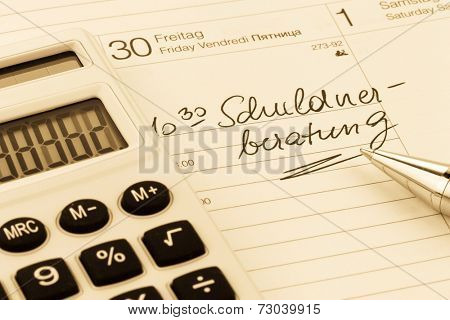 calendar entry debt, symbol photo for personal bankruptcy and poverty