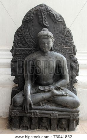 KOLKATA, INDIA - NOV 24: Buddha in Bhumisparsha mudra, from 10th century found in Bihar now exposed in the Indian Museum in Kolkata, on Nov 24, 2012