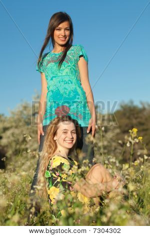 Two Beautiful Young Women In Blooming Meadow