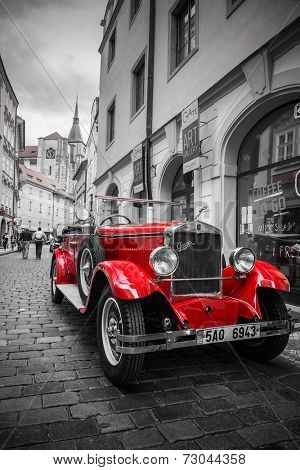 PRAGUE, CZECH REPUBLIC - 21 JUNE 2014 - Famous historic red car Praga in Prague street. Praga is a manufacturing company founded in 1907 based in Prague, Czech Republic.