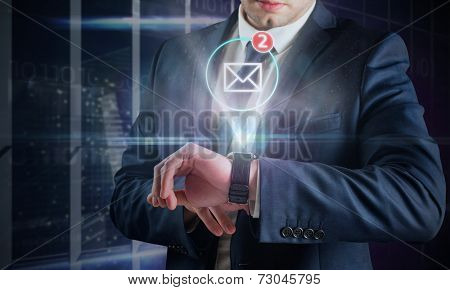 Composite image of businessman using hologram watch in office overlooking city