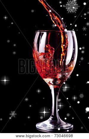 Snow falling revealing empty glass being filled with wine