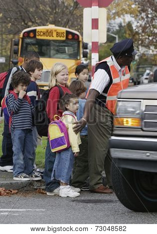 Children on street with crossing guard