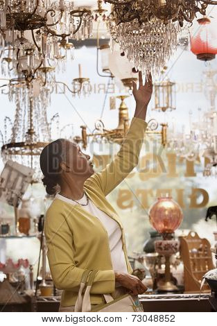 Woman shopping in antique store