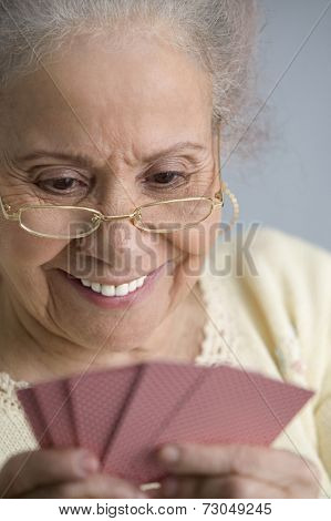 Elderly woman playing cards