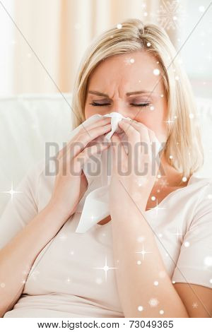 Portrait of an ill woman blowing her nose with snow falling