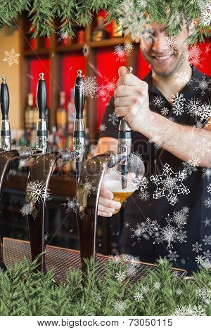 Composite image of a Handsome barkeeper pulling a pint of beer against snow falling