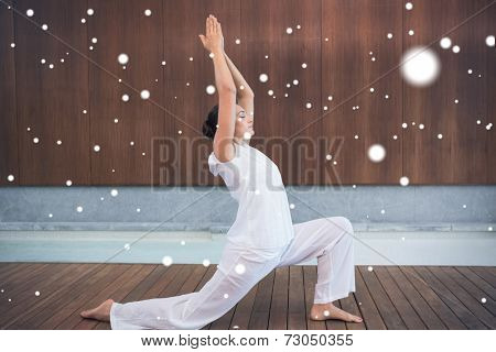 Content brunette in white doing tai chi against snow